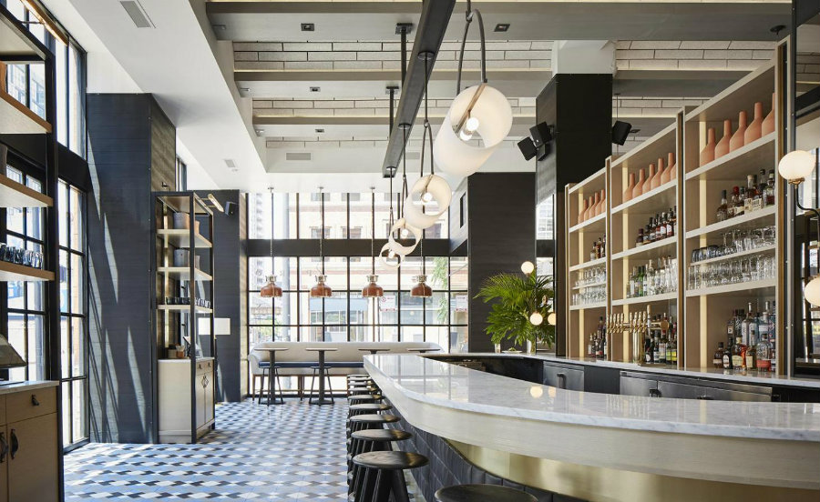 The Proxi Chicago restaurant designed by Studio Meyers. Dining area design with restaurant furniture