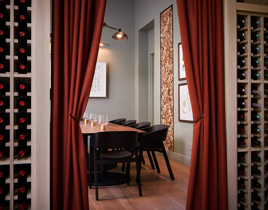 The Proxi Private dining room with black chairs and wood rectangular table