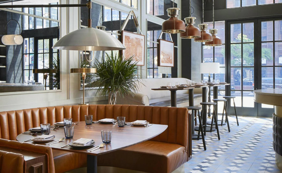Restaurant seating area with orange leather booths